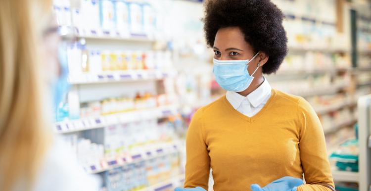 Woman in pharmacy in mask Covid