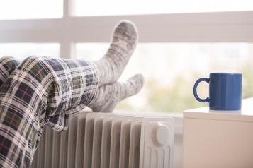 Person keeping warm at home