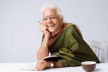 Woman Reading and Laughing